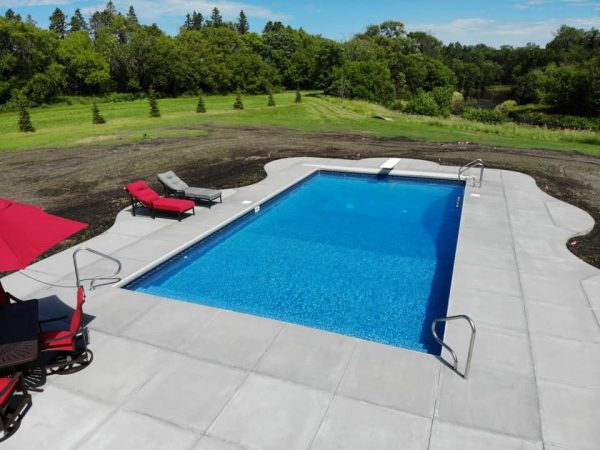 In-ground pool installed by Tubs of Fun